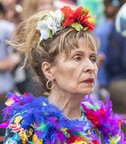 An older woman in a colorful dress with feathers attending the Gay Pride parade also known as Christopher Street Day, Munich. 2018: An older woman in a colorful royalty free stock images