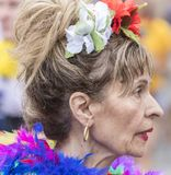 An older woman in a colorful dress with feathers attending the Gay Pride parade also known as Christopher Street Day, Munich. 2018: An older woman in a colorful stock photo