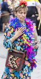 An older woman in a colorful dress with feathers attending the Gay Pride parade also known as Christopher Street Day, Munich. 2018: An older woman in a colorful stock image