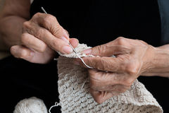 Older woman crocheting Royalty Free Stock Photography
