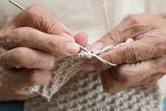 Older woman crocheting Royalty Free Stock Photos