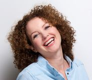 Older woman with curly hair laughing Stock Photography