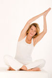 Older woman doing yoga Stock Images