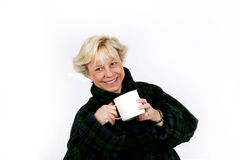 Older woman drinking coffee Royalty Free Stock Photo