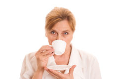 Older woman drinking tea Royalty Free Stock Images