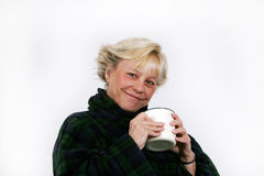 Older woman enjoying coffee Stock Images