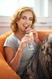 Older woman enjoying a drink at restaurant Royalty Free Stock Images