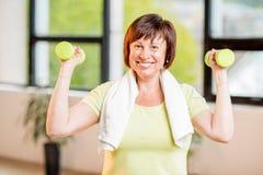 Older woman exercising indoors stock photos