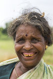 Older woman farmer with bad teeth. Royalty Free Stock Photography