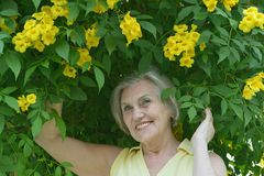 Older woman with flowers Stock Photo