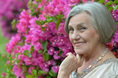 Older woman with flowers Royalty Free Stock Image