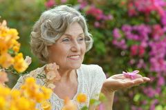 Older woman with flowers Royalty Free Stock Photography