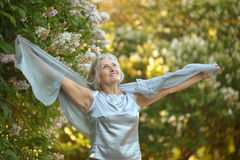 Older woman with flowers Royalty Free Stock Photo
