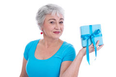 Older woman with gift for Mother's Day isolated on white Royalty Free Stock Photography