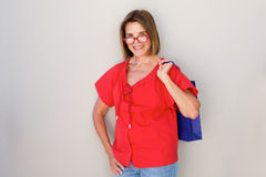 Older woman with glasses holding shopping bags Royalty Free Stock Images
