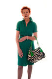 Older Woman in Green Dress and Striped Purse Royalty Free Stock Photo