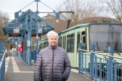 older woman and tram stop Royalty Free Stock Images