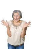 Older woman is happily. Surprised on white background Royalty Free Stock Photo