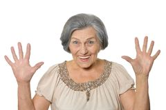 Older woman is happily Royalty Free Stock Photos