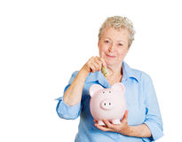 Older woman happy with saving Royalty Free Stock Photography