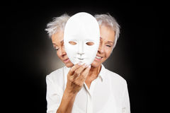 Free Older Woman Hiding Happy And Sad Face Behind Mask Royalty Free Stock Photos - 84411968