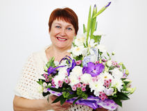 Older woman holding a ikebana Royalty Free Stock Photography
