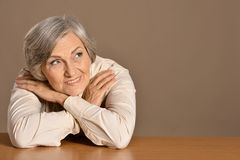 Older woman at home. Portrait of a happy older woman at home Royalty Free Stock Photos