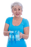 Older woman isolated in white with turquoise shirt and present Stock Photo