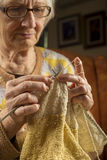 Older woman knitting Royalty Free Stock Photo