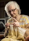 Older woman knitting Royalty Free Stock Image