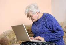 Older woman on laptop Royalty Free Stock Images