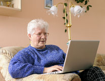 Older woman on laptop Stock Photo