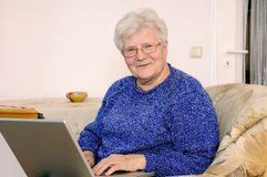 Older woman on laptop Stock Photography