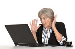 Older woman with a laptop Royalty Free Stock Photos