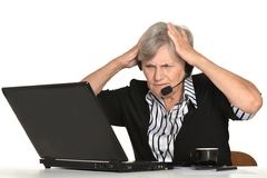 Older woman with a laptop Stock Photography
