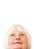 Older woman looking up at copyspace Royalty Free Stock Photography
