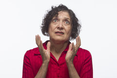 Older woman looking up in disbelief, horizontal Royalty Free Stock Photography