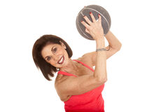 Older woman medicine ball lift up twist Stock Photography