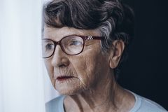 Older woman with memory problems. Close-up of face of sad older woman with memory problems Royalty Free Stock Photos