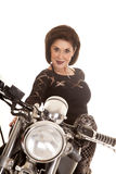 Older woman on motorcycle close smile Stock Images