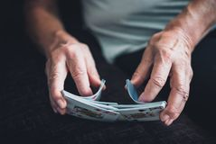 Older woman playing cards Royalty Free Stock Images