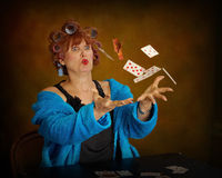 Older woman playing cards. Funny Stock Photography