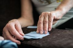 Older woman playing cards Royalty Free Stock Photo