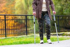 Older woman practicing walking on crutches Royalty Free Stock Photography