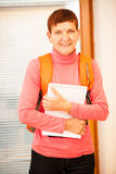 Older woman representing lifelong learning. Woman with school ba Royalty Free Stock Photography