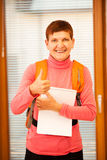 Older woman representing lifelong learning. Woman with school ba Royalty Free Stock Photo