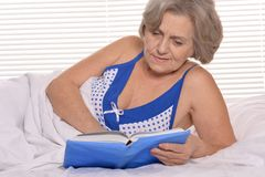 Older woman resting in the bedroom Royalty Free Stock Image
