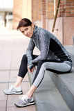 Older woman resting outside after workout Stock Photography