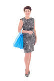 Older woman with shopping bags Stock Image