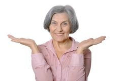 Older woman showing Stock Photo